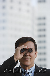 Asia Images Group - Businessman looking though binoculars