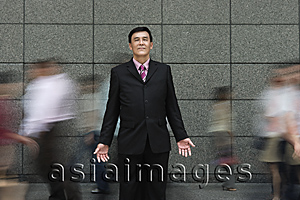 Asia Images Group - Businessman standing in crowd