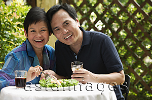 Asia Images Group - Mature couple at restaurant smiling at camera