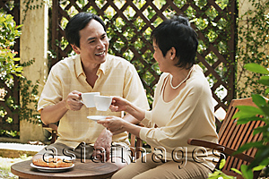 Asia Images Group - Mature couple having tea in the garden