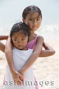 Asia Images Group - Sisters hugging at the beach