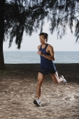 Man running along beach, workout - Yukmin