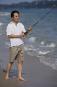 Man fishing at the beach - Alex Mares-Manton
