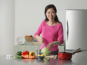 AsiaPix - Mature woman in kitchen, preparing food