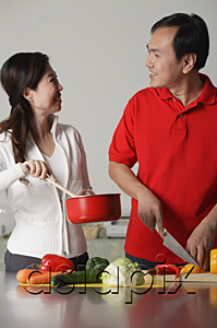 AsiaPix - Couple in kitchen, preparing a meal together