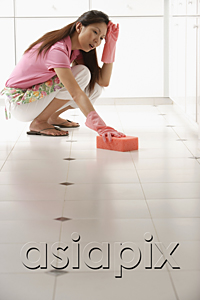 AsiaPix - Woman tired of cleaning kitchen floor with big pink sponge