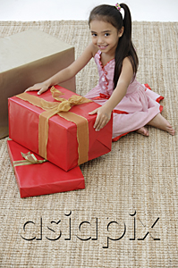 AsiaPix - A young girl at a party with a birthday present