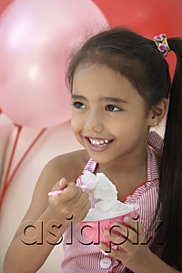 AsiaPix - A young girl at a party with balloons