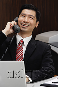AsiaPix - A businessman on the telephone