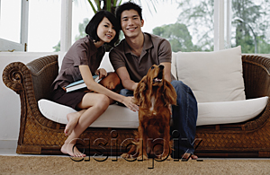 AsiaPix - A young couple with a dog look at the camera