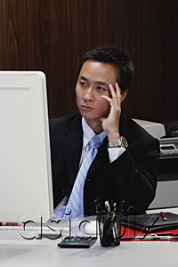AsiaPix - A man concentrates as he works at his desk