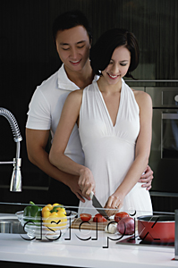 AsiaPix - A couple prepare dinner together in the kitchen