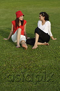 AsiaPix - Young women in park, looking at each other