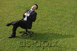 AsiaPix - Businessman resting on an office chair