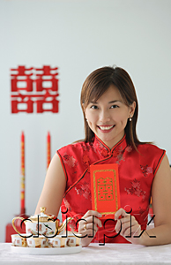 AsiaPix - Young woman in traditional clothing, smiling at camera