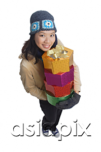 AsiaPix - Young woman with gift boxes, smiling at camera
