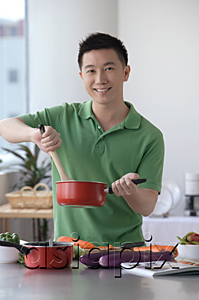 AsiaPix - Man cooking in the kitchen