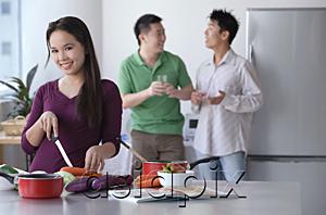 AsiaPix - Woman cooking while men talk