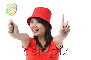 AsiaPix - Young woman with lollipop smiling at camera