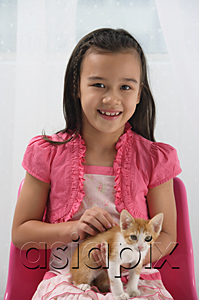 AsiaPix - Young girl with kitten on her lap