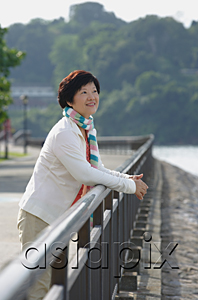 AsiaPix - Woman at the waterfront looking into distance