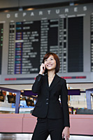 Young woman with mobile phone at the airport - Asia Images Group
