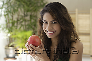 PictureIndia - A woman eating fruit