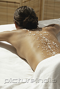 PictureIndia - A woman relaxes at a spa