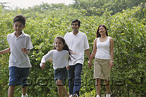PictureIndia - A family walk together in the park