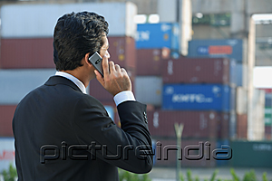 PictureIndia - Businessman talking on mobile phone