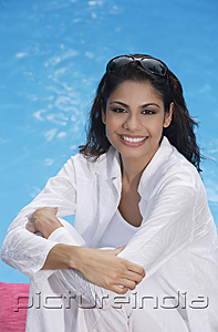 PictureIndia - Woman sitting by the pool