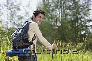PictureIndia - Young man hiking in the wilderness